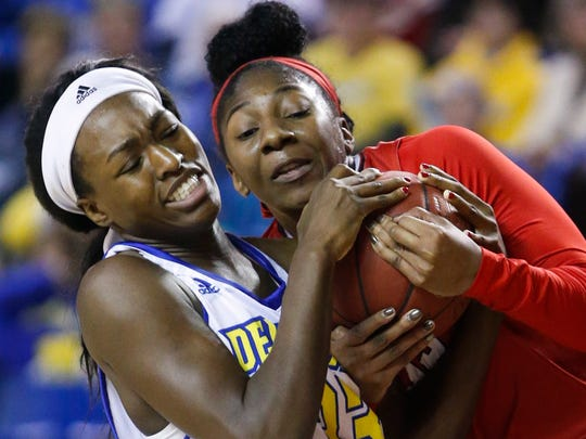 Delaware's Nicole Enabosi (left) tries to fight off Hartford's Janelle Harrison in the first half at the Bob Carpenter Center Wednesday.