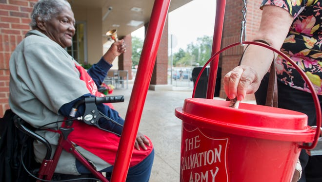Salvation Army volunteer Alma Crumpton rings her bell Friday, Dec. 22, 2017, as someone makes a donation outside of Publix on Cervantes Street in Pensacola.