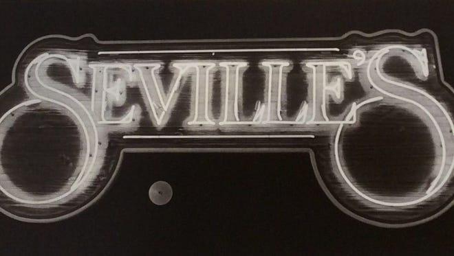 The neon sign at Seville's restaurant/lounge in October 1986.