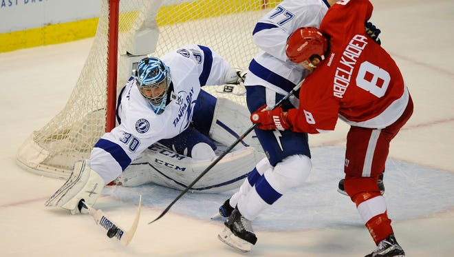Lightning goalie Ben Bishop reaches out for the puck as Victor Hedman battles with Justin Abdelkader during Game 3 Sunday night.