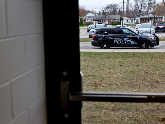 A police cruiser is parked outside during a random