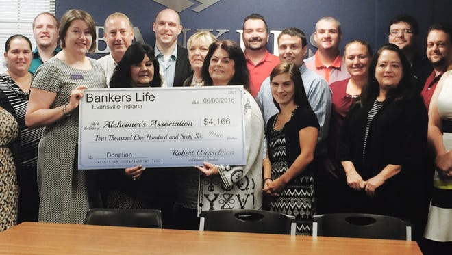Bankers Life gift The Evansville Branch of Bankers Life collected more than $4,000 for Alzheimer's during the company's 14th Annual Forget Me Not Days. The North Green River, Boonville - New Harmony and Newburgh Schnucks locations participated along with more than 20 volunteers from Bankers Life for this year's successful event. Branch manager Robert Wesselman says this was a record one day collection for the Evansville office. Hundreds of offices nationwide have collected over a half million dollars during the past 14 years of this event. Posing with the check are, from left Alzheimer Representative Sally Payne, Joy Bell, Guylene Ramberger, Rachelle Allen and Jean Henderson. Standing in back from left are Brittany Mason, Lindsey Pittman, Colin Hawkins, Robert Wesselman, Paul Kemper, Lynne Finney, Derek Brass, Matt Krieg, Daniel Woods, Amanda Clifford, Dilland Gallant, Joe Casebolt and Courtney Wilson.