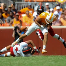 Sep 6, 2014; Knoxville, TN, USA; Arkansas State Red Wolves defensive back Money Hunter (27) knocks the ball loose from Tennessee Volunteers quarterback Justin Worley (14) during the second half at Neyland Stadium. Tennessee won 34 to 19. Mandatory Credit: Randy Sartin-USA TODAY Sports