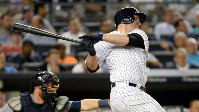 Yankees catcher Brian McCann hits a solo home run in the seventh inning against the Detroit Tigers at Yankees Stadium on Wednesday night.