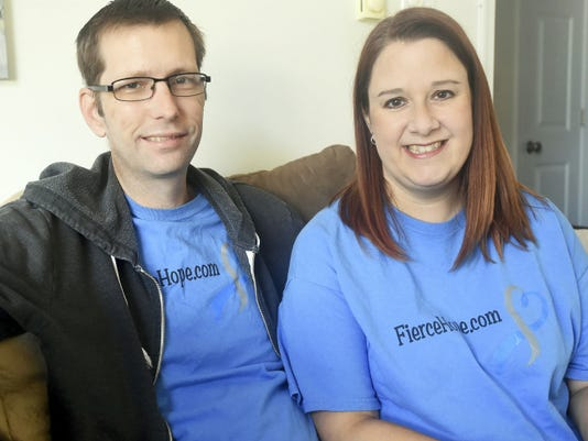 James Ross, left, is a cancer victim who is fighting to live on. Here he is pictured with his wife Amy Ross on Wednesday.