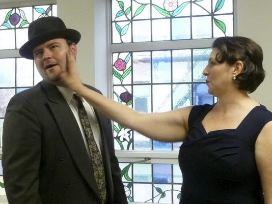 "Mathew Barninger of Hanover as gambler Sky Masterson is put in his place by Stephanie Allee of Fayetteville as mission ""doll"" Sarah Brown in CCT's production of ""Guys & Dolls"" opening May 8 at Capitol Theatre, Chambersburg."