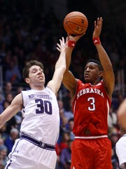 Nebraska Cornhuskers guard Andrew White (3) shoots over Northwestern Wildcats guard Bryant McIntosh (30) in the first half at Welsh-Ryan Arena. Mandatory Credit: Jerry Lai-USA TODAY Sports