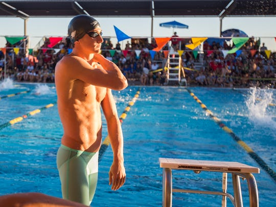 Chaparral's Ryan Hoffer waits for his final race during the State Tournament at the Skyline Aquatic Center in Mesa on Nov. 8, 2014.