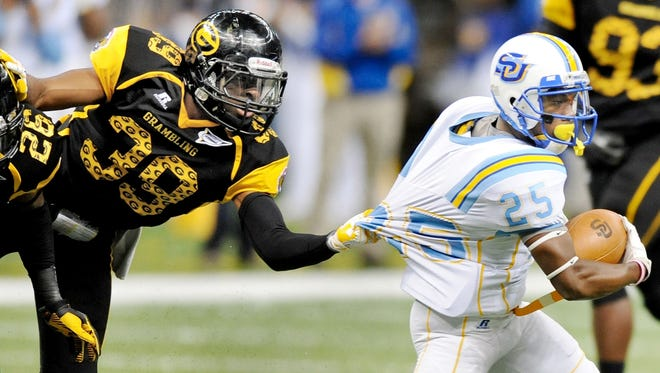 Grambling State defensive lineman Michael Harris attempts to slow down Southern University's Willie Quinn.