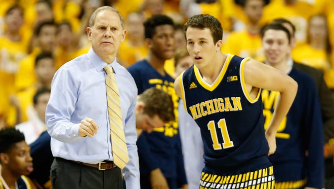Michigan coach John Beilein talks with Andrew Dakich during the second half against Maryland at Xfinity Center on Feb. 21, 2016 in College Park, Md.
