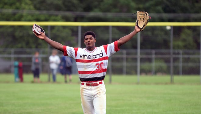 Vineland's Isiah Pacheco (30) celebrates a 5-1 win over Millville Thursday, June 8, 2017 at Millville High School.