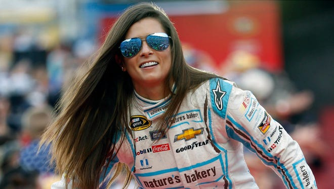"""FILE - In this July 2, 2016, file photo, Danica Patrick greets fans during driver introductions before the start of the NASCAR Sprint Cup auto race at Daytona International Speedway, in Daytona Beach, Fla. Danica Patrick is done at Stewart-Haas Racing and her future in NASCAR is now up in the air amid a sponsorship shake-up. Patrick posted a statement on her Facebook page Tuesday, Sept. 12, 2017 saying her time with Stewart-Haas """"had come to an end"""" due to a new sponsorship arrangement for the team next season."""