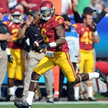 Josh Shaw recovers a Utah fumble in an NCAA college football game in Los Angeles. Shaw confessed that he lied to school officials about how he sprained his ankles last weekend, retracting his story about jumping off a balcony to save his drowning nephew.