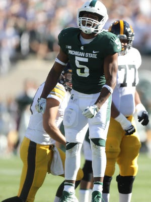 Michigan State's Andrew Dowell celebrates after a stop against Iowa during the first quarter on Saturday, Sept. 30, 2017, at Spartan Stadium in East Lansing.