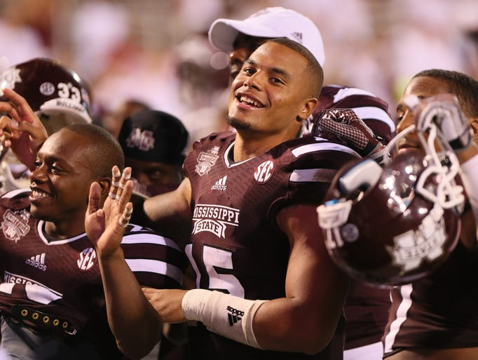 MSU quarterback Dak Prescott celebrates with teammates after defeating USM 49-0. Mississippi State and the University of Southern Mississippi played a college football game on August 30, 2014 at Davis Wade Stadium in Starkville. (Photo by Kevin Warren)