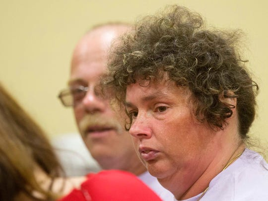 Louisia Cass sits during the video arraignment of Wendell Noyes, Tuesday June 21, 2016, in district court in Berlin, N.H.  Noyes is charged with second-degree murder in the death of her 11-year-old daughter Celina Cass. The girl was reported missing from her home July 26, 2011. Her body was recovered from the Connecticut River six days later. (AP Photo/Jim Cole, Pool)