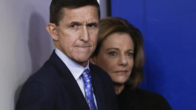 FILE - This Feb. 1, 2017, file photo shows then-National Security Adviser Michael Flynn, joined by K.T. McFarland, then-deputy national security adviser, during the daily news briefing at the White House, in Washington. McFarland is an unnamed senior official referred to in the court papers filed in the Flynn case. She was involved in a discussion with Flynn about what he would say to Russian government officials in response to U.S. sanctions imposed on Russia last year. (AP Photo/Carolyn Kaster, File)