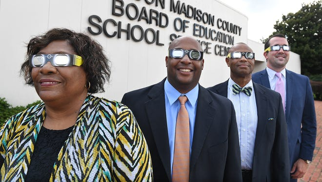 Vivian Williams, Eric Jones, Ray Washington and Jared Myracle test out their solar eclipse glasses outside of the Jackson Madison County Board of Education in 2017.