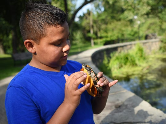 Sam Ibold, 12, is sometimes harassed for catching frogs