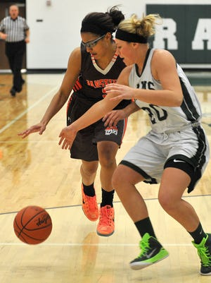 Mansfield Senior's Jeryn Reese and Madison's Kaylie Baker chase down the ball during their game Thursday night.