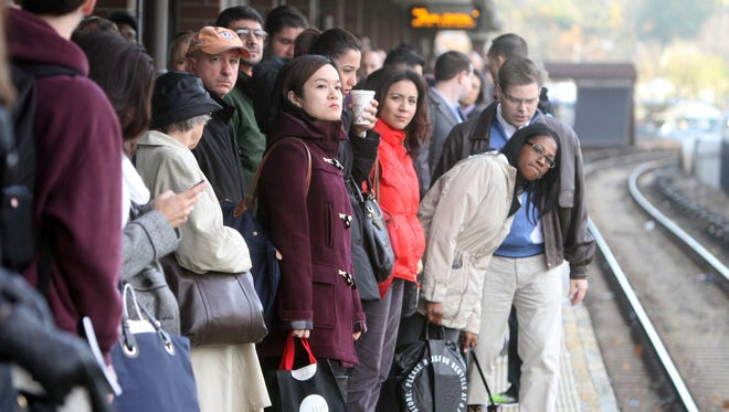 Commuters wait for a Metro-North train at the White Plains station in this file photo.