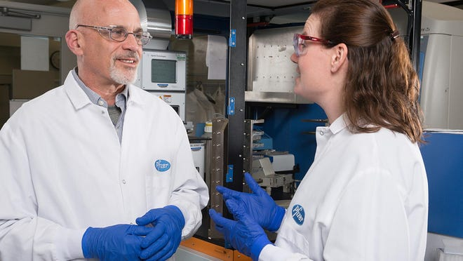 Pfizer Discovery medicinal chemist Jotham Coe, left, invented the smoking-cessation drug Chantix after watching several members of his family die from smoking-related illnesses.