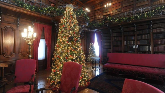Christmas decorations adorn the library inside the Biltmore House in a past season.