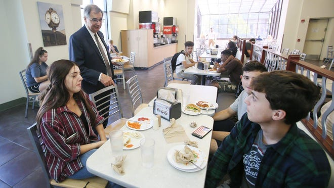University of Akron president Gary Miller talks to students eating at Rob's Cafe on his first day as president on Oct. 1, 2019.