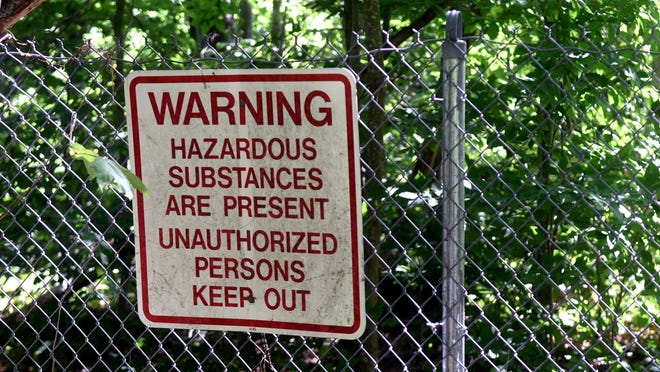The Dover Municipal Landfill site is located on Tolend Road and is gated with signs warning of hazardous substances.