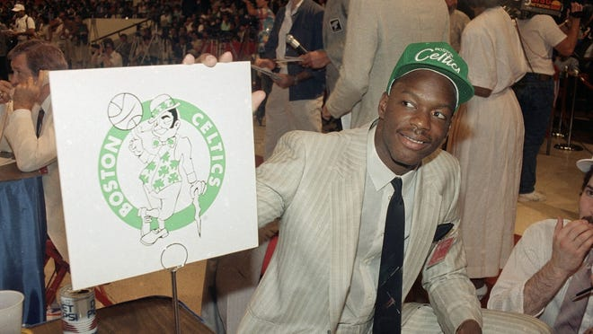 Boston Celtics draft pick Len Bias is shown at the Celtics draft table in New York in this file photo from June 17, 1986.  Two days after being selected by the Celtics as the No. 2 pick in the 1986 NBA draft Bias died of cocaine intoxication.