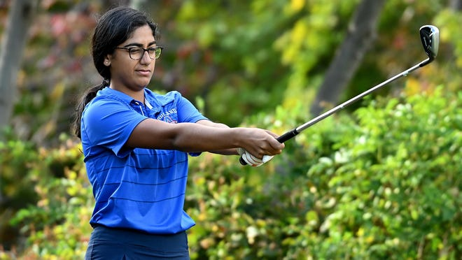 Ashland sophomore Keira Joshi sizes up a tee shot during against Medway at Pinecrest Golf Club in Holliston.  Her twin brother Kyzar was playing in the same group.