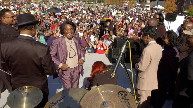 James Brown laughs as the crowd cheers for him during James Brown Day festivities held at the Augusta Common Nov. 15, 2003.