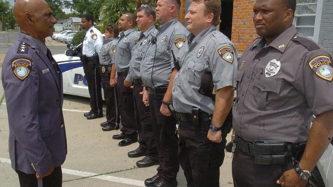 "Washington Police Chief Ronelle ""Bruce"" Broussard (left) performs an inspection on his officers in preparation for the town's annual Catfish Festival in 2013."