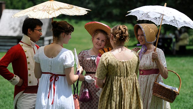 Participants dressed in regency attire gather to chat at the 6th Annual Jane Austen Festival Saturday at Locust Grove. July, 20, 2013