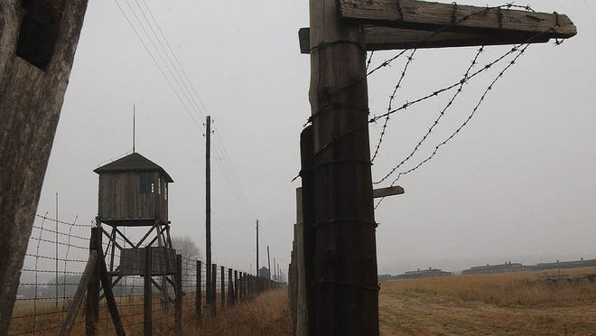 A Nov. 9, 2005, file photo shows watchtowers and a barbed wire fence of the former Nazi death camp Majdanek outside the city of Lublin in eastern Poland.