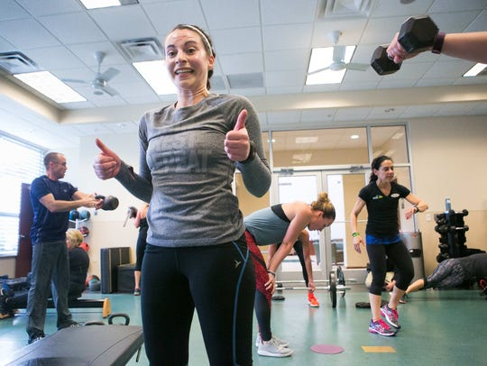 Health reporter Jen Rini hangs in there by giving two