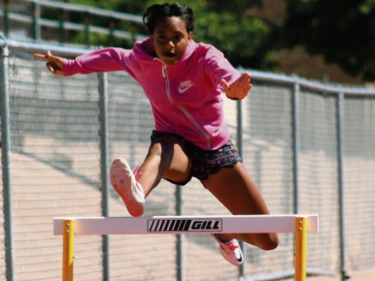 Alexandria Adams works on her hurdle jumping Wednesday afternoon at Tiger Stadium.