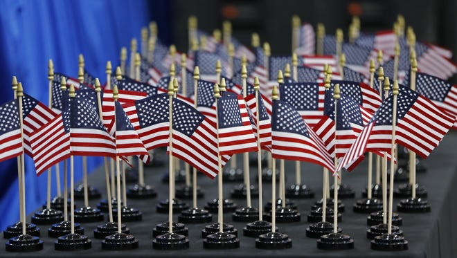Small American flags sit on a table at the Indiana Latino Expo at the State Fairgrounds on Oct. 7, 2016, for a naturalization ceremony for 100 new citizens.