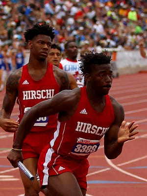 Hirschi's Daimarqua Foster takes off after receiving the handoff from teammate Javen Banks during the 4x200 relay Saturday during the UIL Track & Field Championships held at Mike Myers Stadium in Austin.