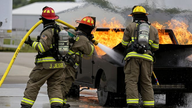 Members of Clayton Fire Rescue demonstrate putting out a car fire during Fox Valley Tech's Public Safety Day at the Training Center as various departments provide demonstrations for the public Saturday, August 13, 2016, in Greenville, Wisconsin.