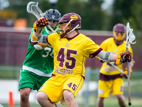 Salisbury University attack Nick Garbarino (45) is guarded by York College midfielder Taylor Tolbert (30) in the Capital Athletic Conference on Saturday, April 30 at Seagull Stadium in Salisbury.