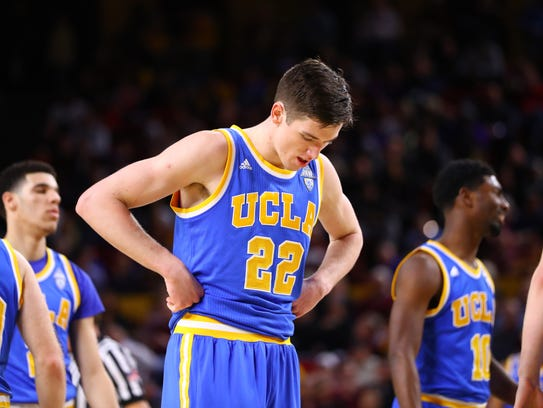 UCLA Bruins guard T.J. Leaf (22) reacts against the