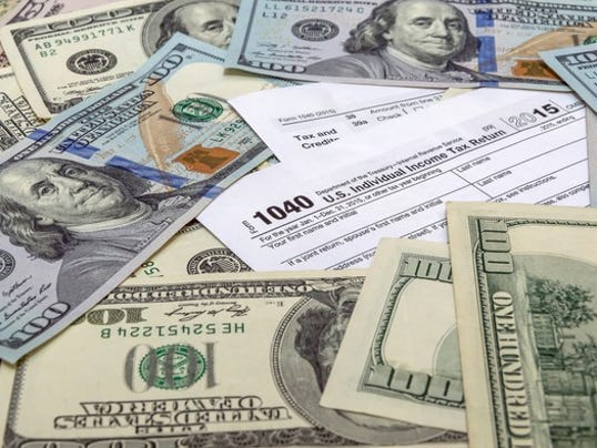 tax-1040-with-money_large.jpg