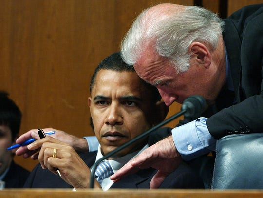 Then-senators Obama and Biden confer during a Foreign