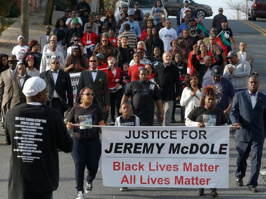 "A protest of the fatal shooting by police of Jeremy ""Bam"" McDole is held in Wilmington on Dec. 12. The family of McDole is suing the Wilmington Police Department and the city."