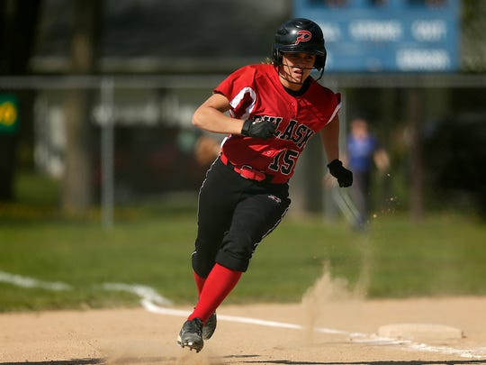 Pulaski's Katie Anderson (15) heads for home plate during Thursday's game against Green Bay Southwest at John Muir Park in Green Bay. Anderson is the only senior on Pulaski's team this season.