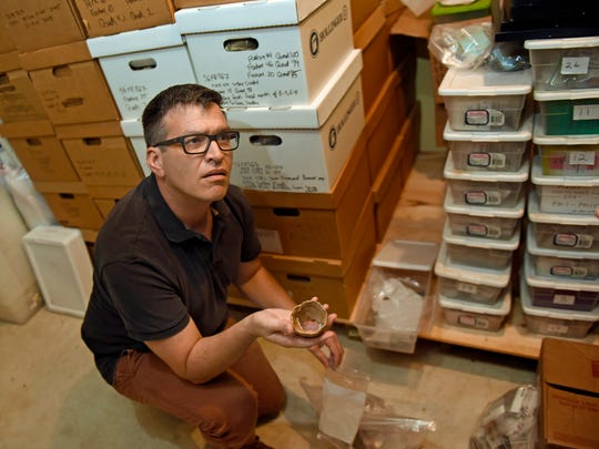 Andy Stout displays ancient items in the barn at Allison-Ebbert house on Sept. 9, 2016 that was discovered during an archaeological dig at the historic farm in Greencastle.