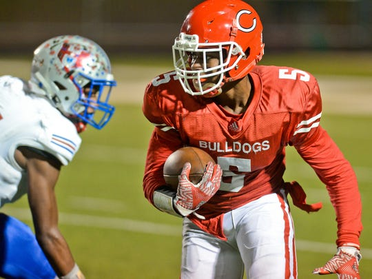 Carthage receiver Mekhi Colbert tries to evade a defender during the Bulldogs' 33-31 regional-round playoff win over Henderson on Nov. 25, 2016, at Longview's Lobo Stadium.