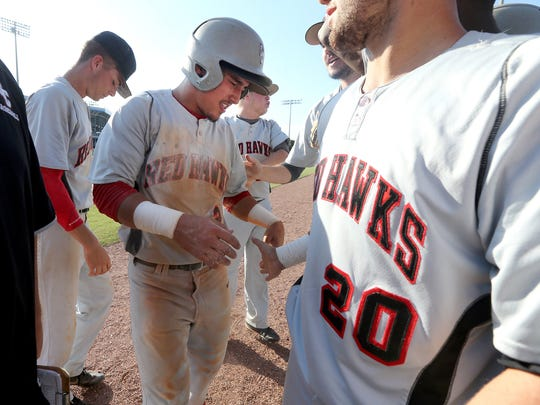 Stewarts Creek Tre Bailliez is congratulated by his team after scoring against Brentwood during the Class AAA Baseball State Championship game at Spring Fling on Friday, May 26, 2017.