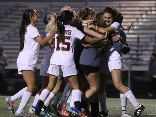 Wichita Falls High School celebrates their win over